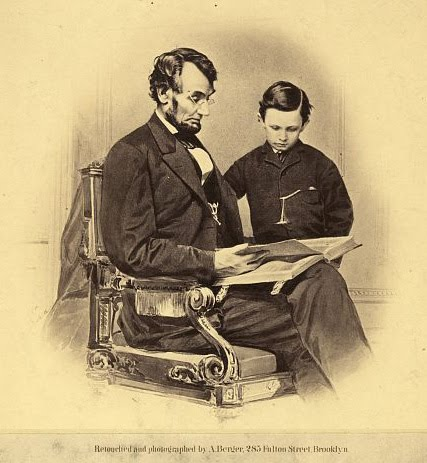 Abraham Lincoln reading to his son Tad