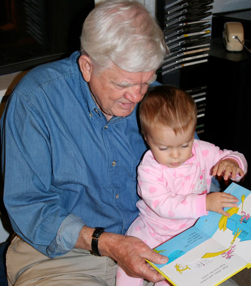Reading with grandpa - image by Flickr user Phil Scoville