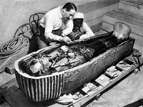 Howard Carter inspecting King Tut's mummy