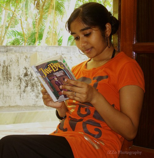 Reading Jane Eyre.  Photo by Easa Shamih under Creative Commons.