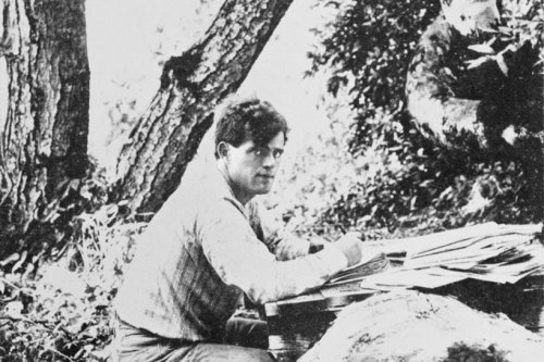 Jack London working in the woods