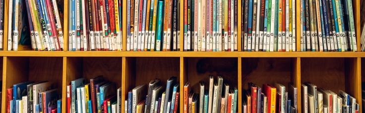 Children's books on shelf, photo by Vlad Vasnetsov from Pixabay